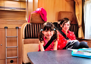Children sitting in motorhome